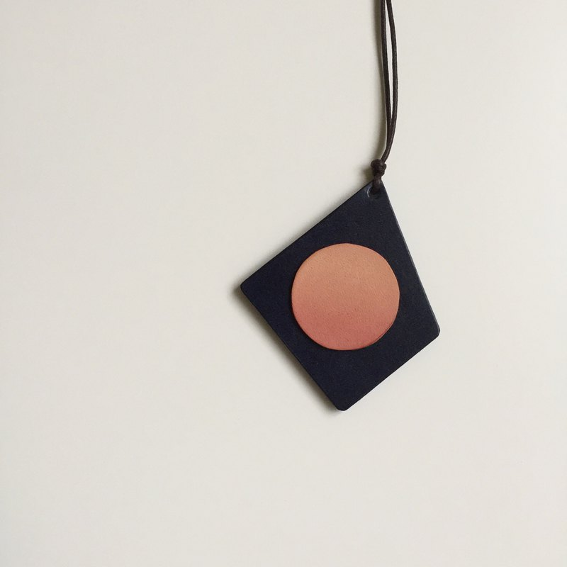 There is a circle in the square. Hand dyed leather irregular geometric necklace
