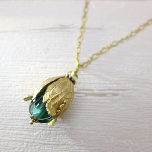 The fruit or flowerbud, Brass and glass necklace, Grayish blue