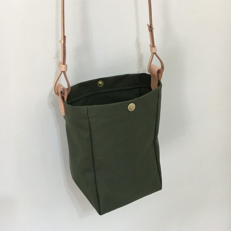 Carrying small bag, army green