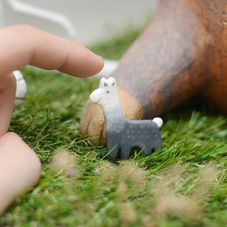 a little grey alpaca handmade brooch from Niyome clay.