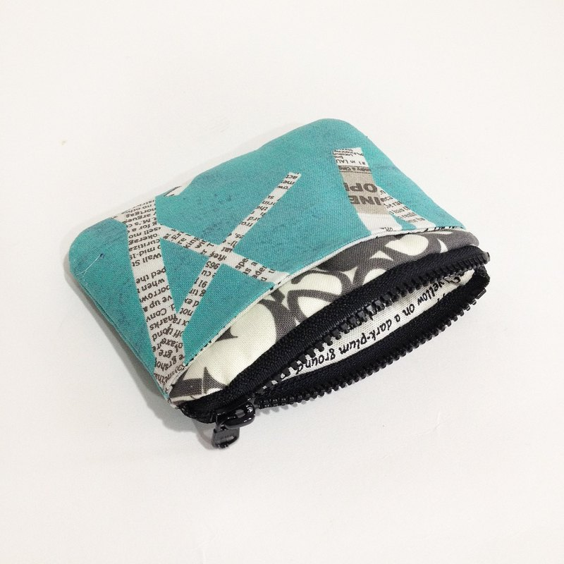 Hand in hand blue green newspaper purse