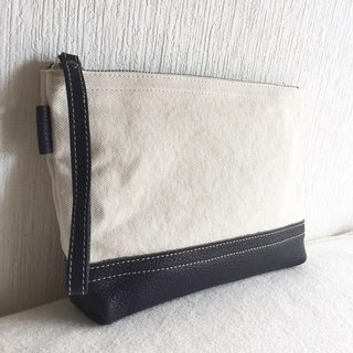 Simple pouch of vintage 8 canvas and goat leather tannin soft dumplings [navy]