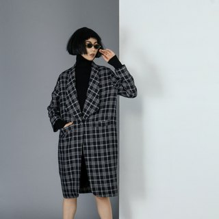 White and black square patterns coat