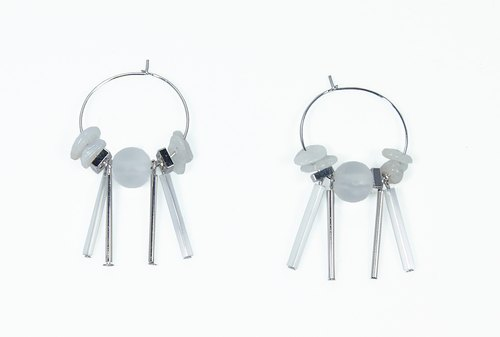 Space age Moonlight earrings on the ears