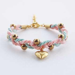 Braided bracelet with gold brass balls and heart charm