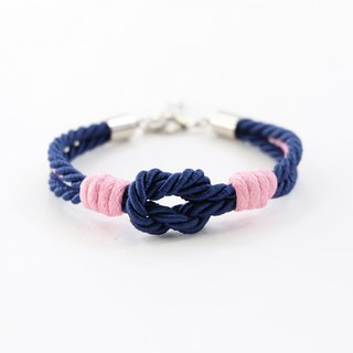 Navy blue knot rope bracelet with pink waxed cotton cord