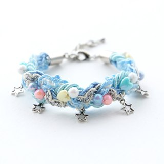 Pastel blue braided bracelet with star charms