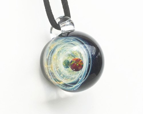 A golden whirlpool world. Glass pendant with black opal Space universe