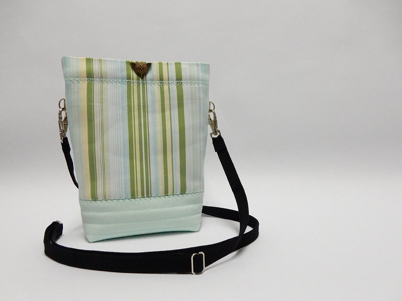 Lined with resin cotton green stripes  little oblique backpack