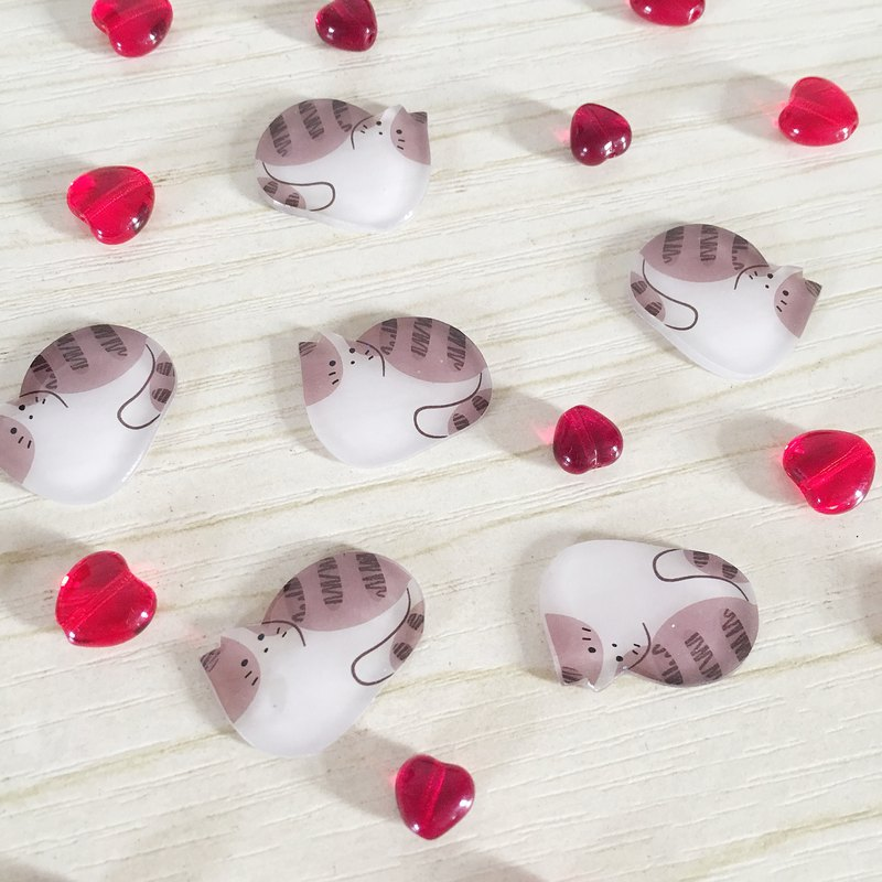 A pair of tea colored Cat Earrings on the island
