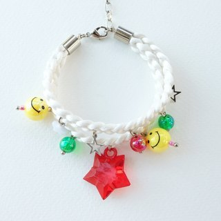 White double-layered braided bracelet with smiley and charms