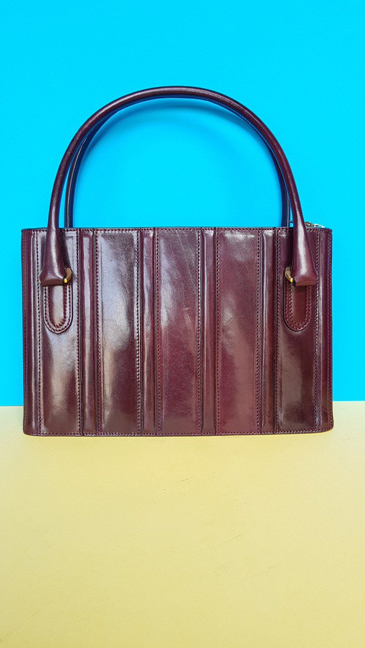 Burgundy leather handbag with vertical stripes bag.