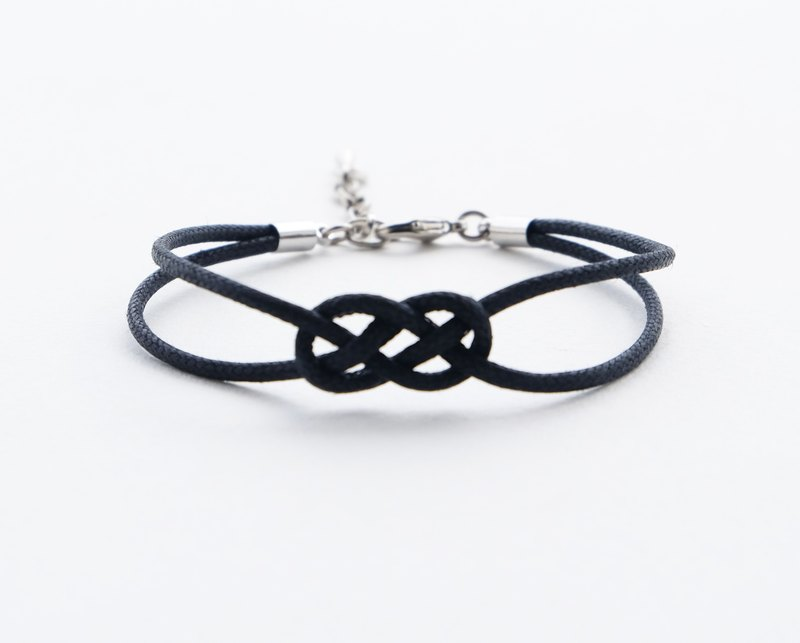 Loose Infinity bracelet in black , waxed cotton cord