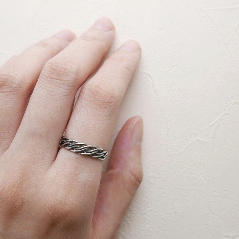 Daily department. Multilayer woven sterling silver ring
