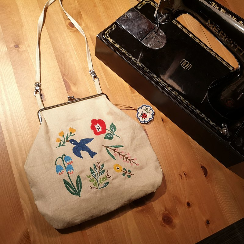 Bluebird in the backyard embroidered linen clutch
