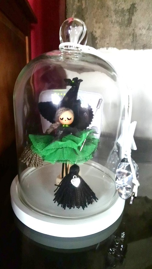 Witch doll in glass bell