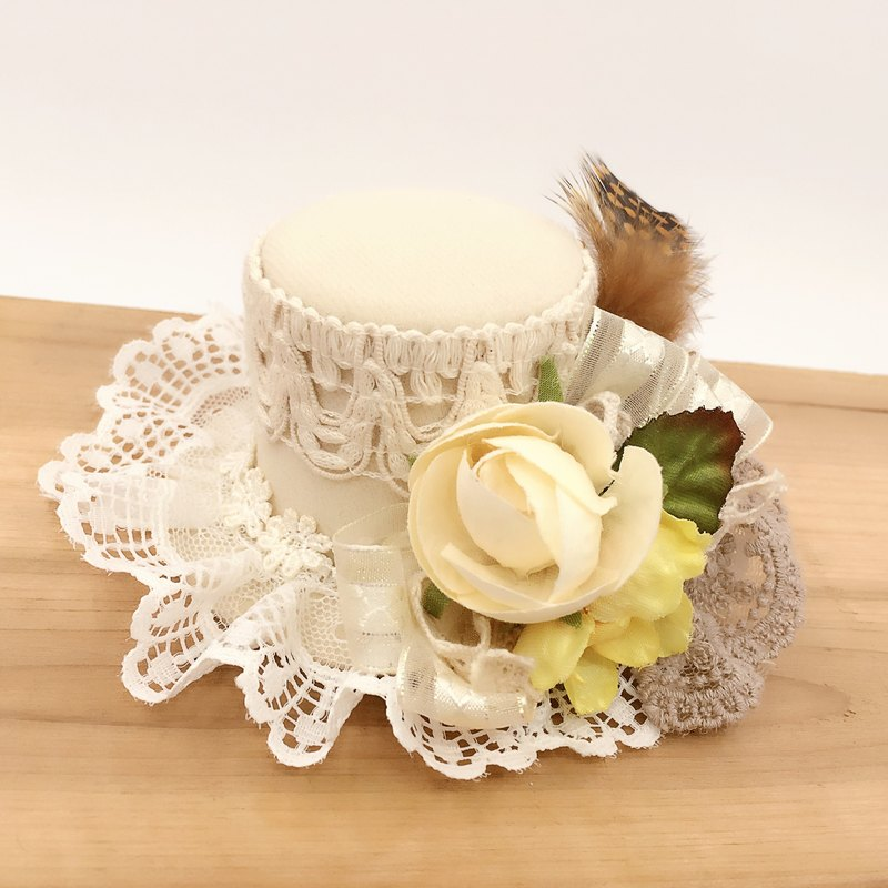 Beige lace hat shape. Hairpin