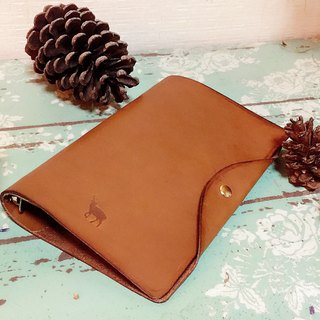 Dark brown tanned leather handbook