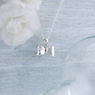 Bow (silver necklace)