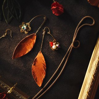 Febbi buckle leather earrings before and after the leaves