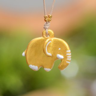 A little golden Thailand elephant handmade necklace from Niyome Clay.