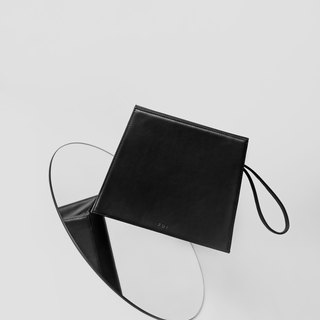 Karpa Clutch in Black - minimalist structured leather clutch