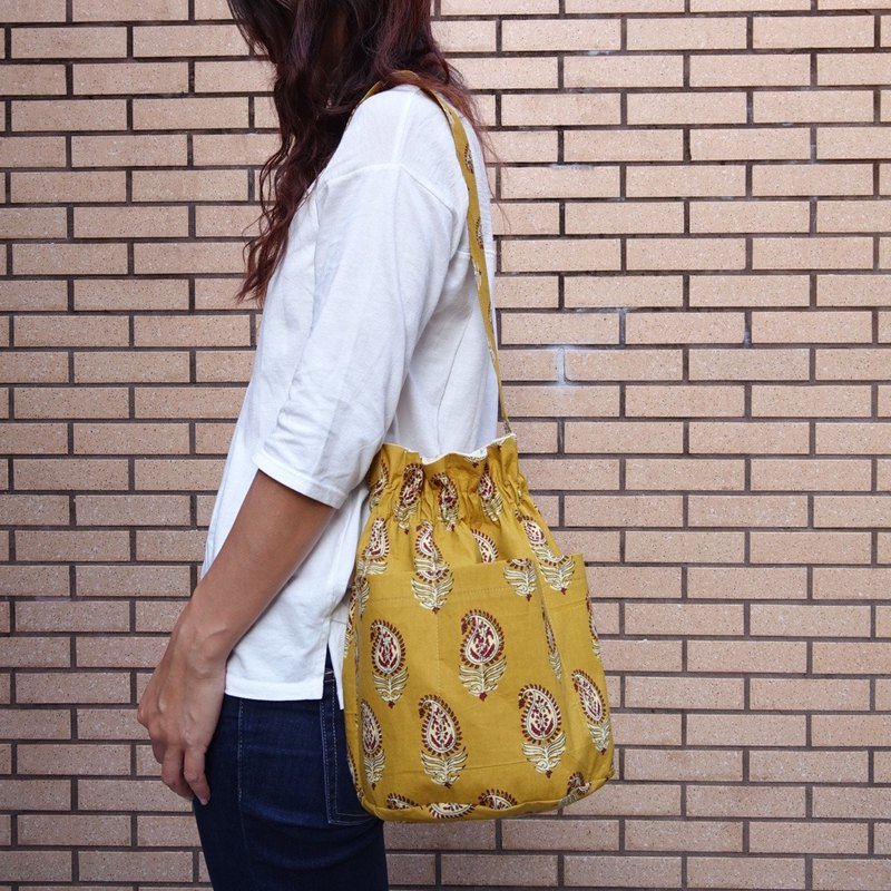 Round based handbag-yellow paisley print