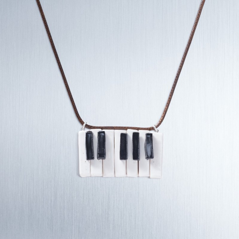 Piano keys. The keys can be stunned - handmade white porcelain necklace