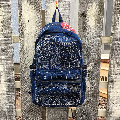 Totally embroidered denim backpack