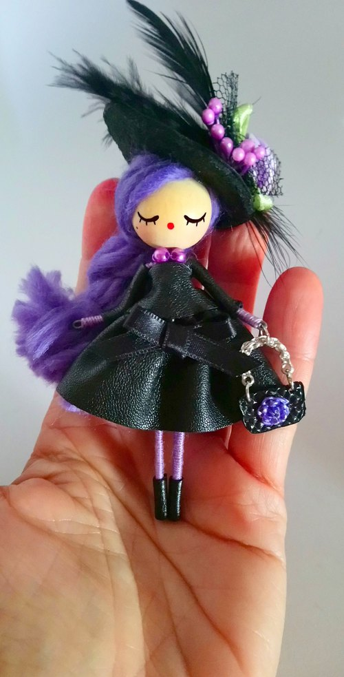 Brooch doll