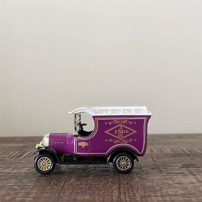 Early British model purple model car with original box