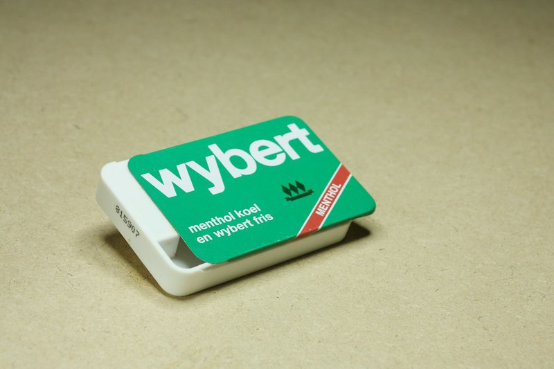Purchased from the late 20th century in the Netherlands, the old Wybert throat candy iron cover plastic box