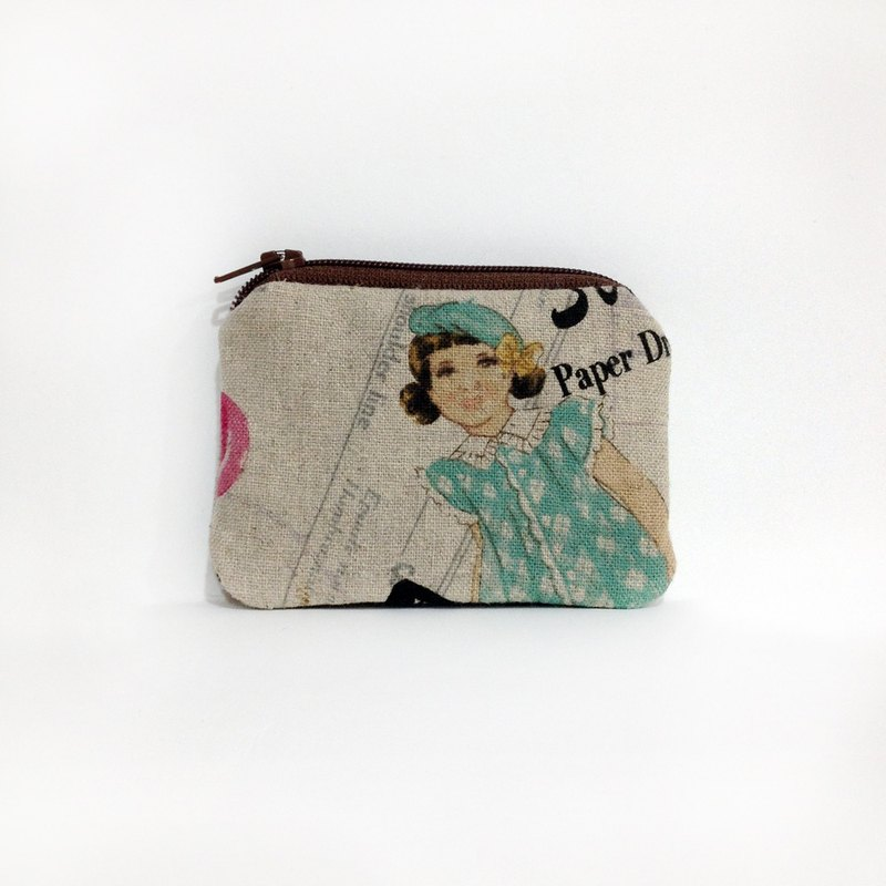 Little girl sewing purse
