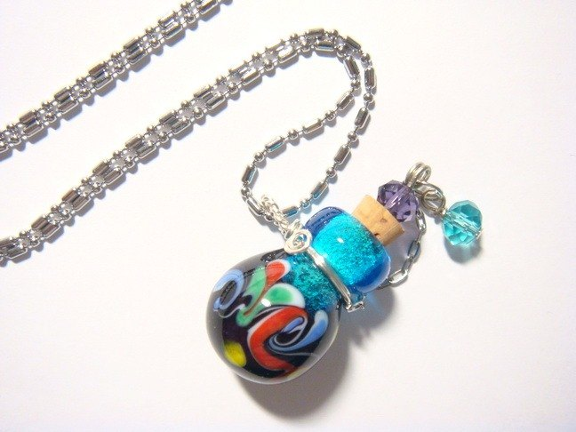 Grapefruit forest handmade glass - essential oil bottle / smell bottle necklace - rainbow after heavy rain (round bottle)