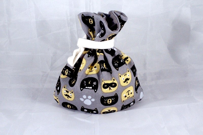 There are mini tote bag bottom - duplex black and yellow kitten