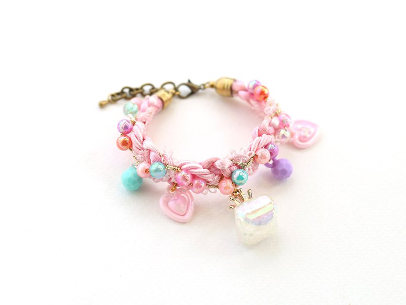 Pink pastel braided bracelet with charms