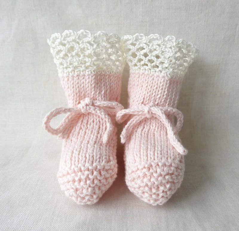 Handknitted lacy baby booties