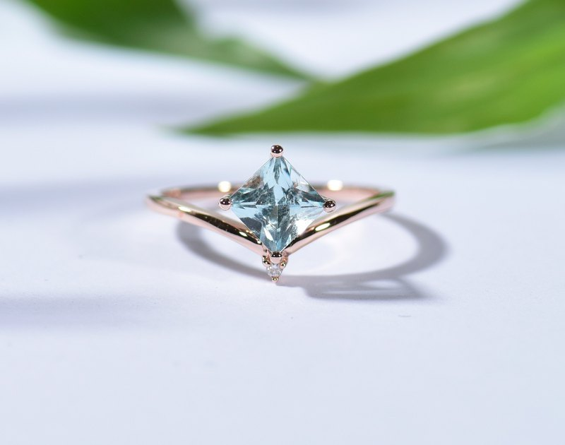 0.5 carat Princess Cut aquamarine ring in solid 18k rose gold on a V shaped band
