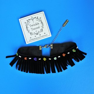 Embroidered beads flocked tassel attached to the necklace