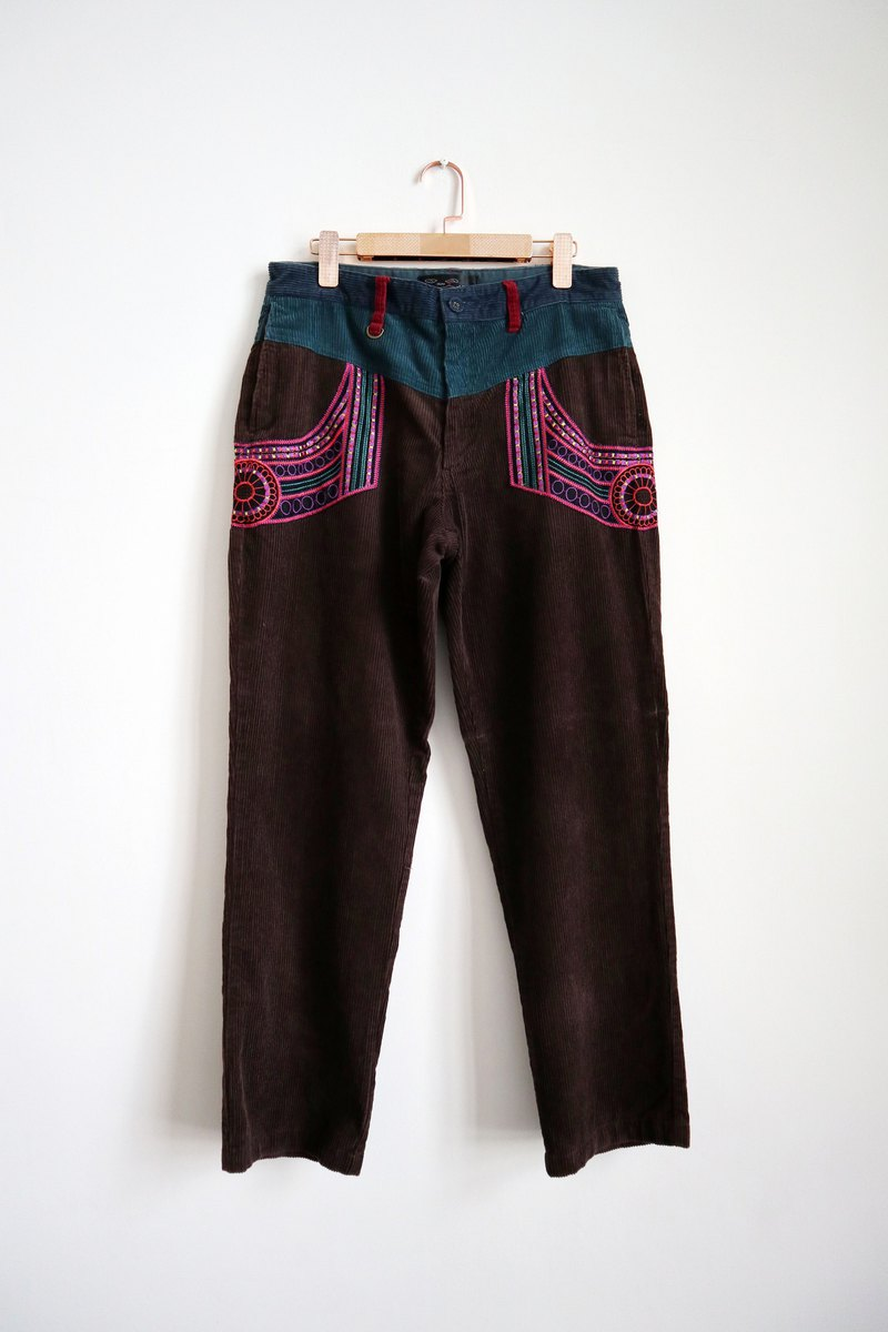 Pumpkin Vintage. Ancient totem embroidered corduroy trousers