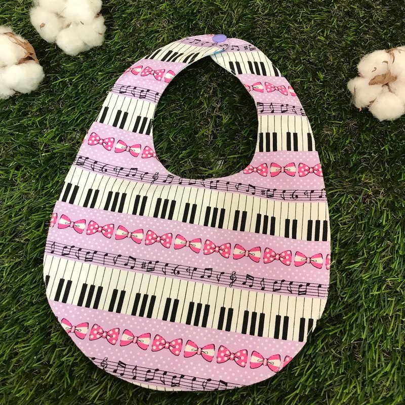 Double-sided bib - piano and bow