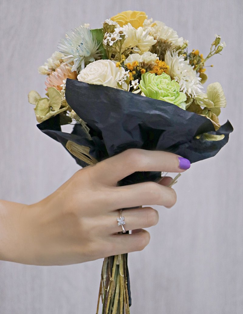 Four petal diamond rings