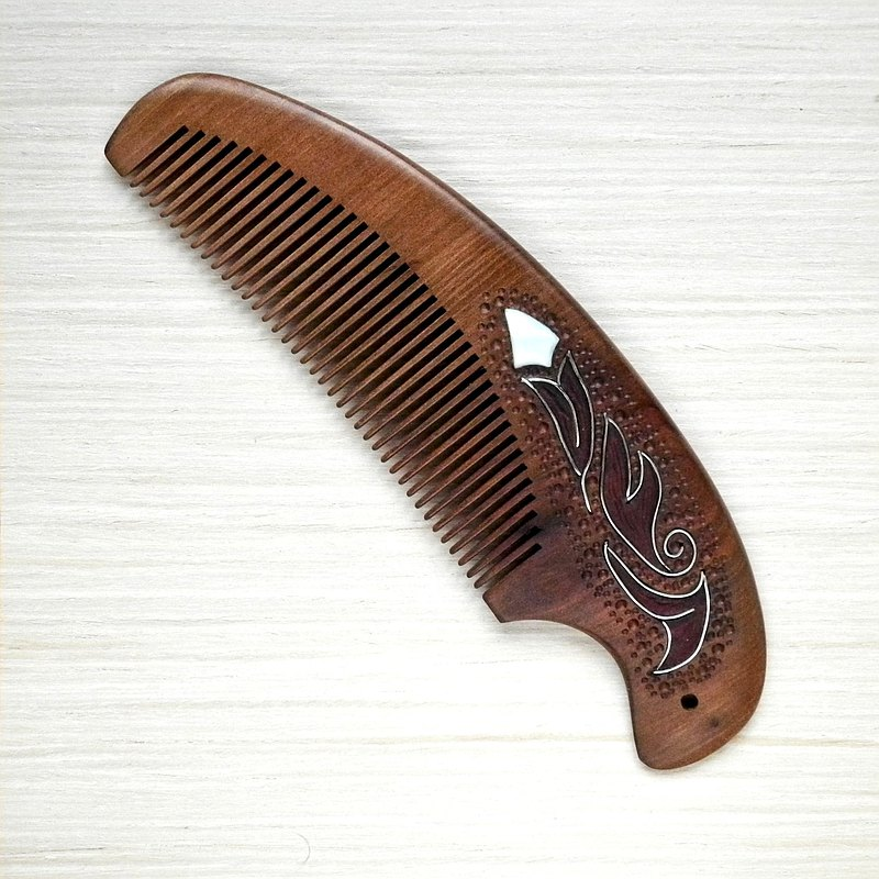 Wooden hair comb with mother of pearl