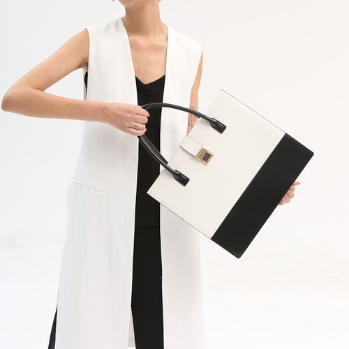 [Sold out] DOUBLE-X independent designer models leather hand bag bag color hand bag - black and white
