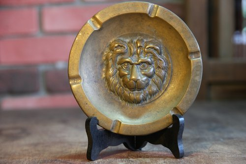 Copper lion ashtray