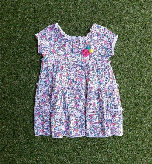 Small colorful flowers in the world dress