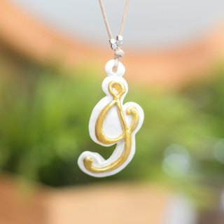The J alphabet letter handmade necklace from Niyome Clay.