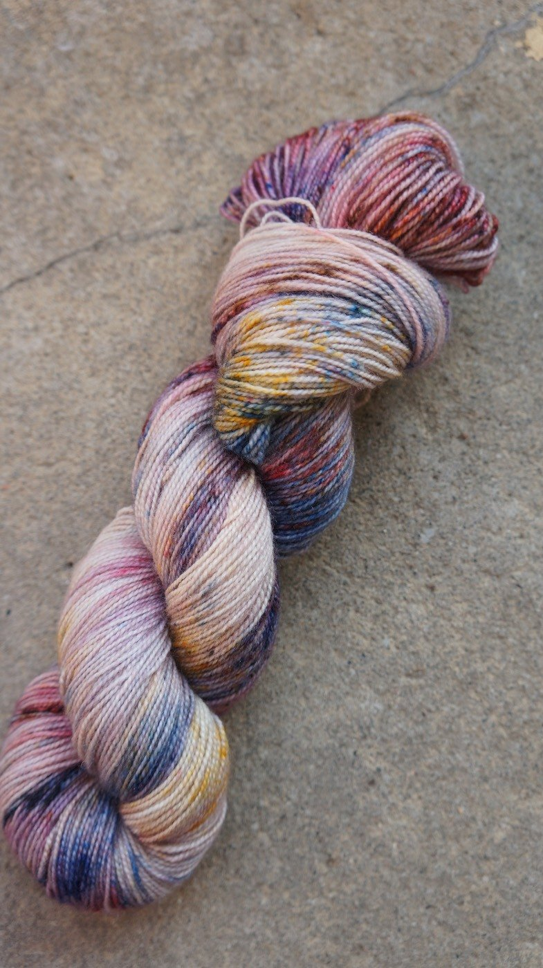 Hand dyed the line. Beads. (Super Wash Merino + Nylon)