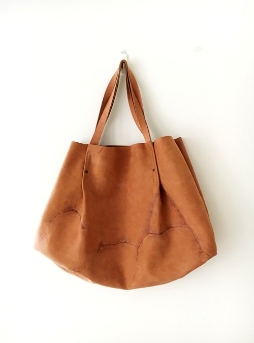 Earth burst leather cowhide bag